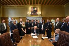 Governor Signing Crumps Law